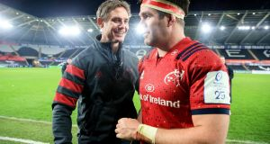 Munster senior coach Stephen Larkham with Billy Holland: In recruiting Graham Rowntree and Stephen Larkham, Munster have brought in fresh creative thinking and vast experience into their organisation. Photograph: Gary Carr/Inpho