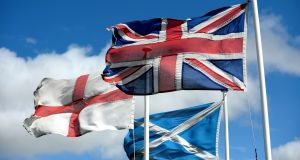 The flags of St George, the flag of Scotland and the union flag fly high. Photograph: Owen Humphreys/PA Wire
