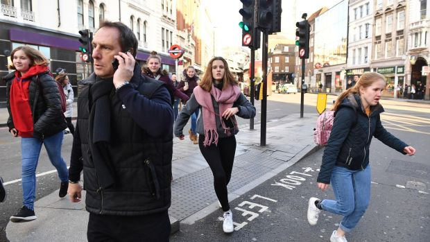 People running away from Borough Market in London after police ask them to leave the area. Photograph: Dominic Lipinski/PA Wire
