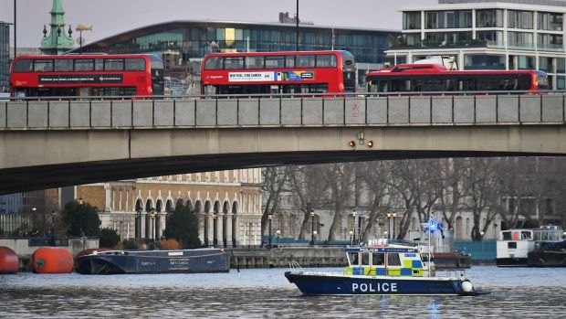 A police boat on the River Thames near London bridge following a 'terror related' incident. Photograph: Dominic Lipinski/PA Wire