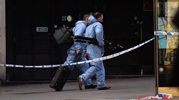 Forensics officers make their way near London Bridge in central London. Photograph: Ben Stansall/AFP via Getty