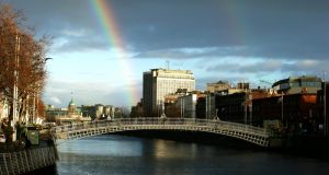 Rainbow over the ha'penny bridge in Dublin's city centre today. Photograph: Stephen Collins/Collins Photos