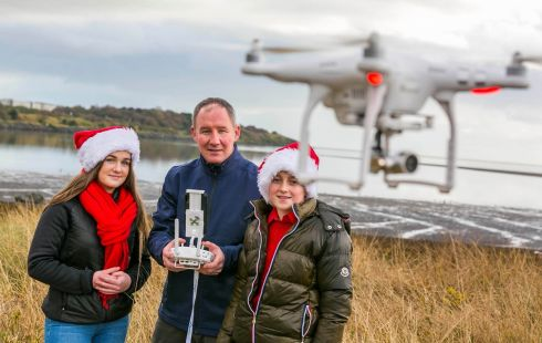 FLYING SQUAD: The Irish Aviation Authority's assistant director Jim Gavin with 13-year-old Sean Haskin and 14-year-old Aalayiah Watters. Photograph: Alan Rowlette