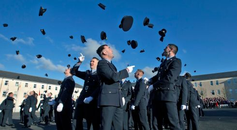 NEW RECRUITS: Newly appointed Gardaí throw their hats in the air earlier on Friday afternoon at the Garda College, Templemore, at the Passing Out Ceremony of 191 probationery gardaí, who will now become serving members of the force. Photograph: Colin Keegan/Collins Dublin
