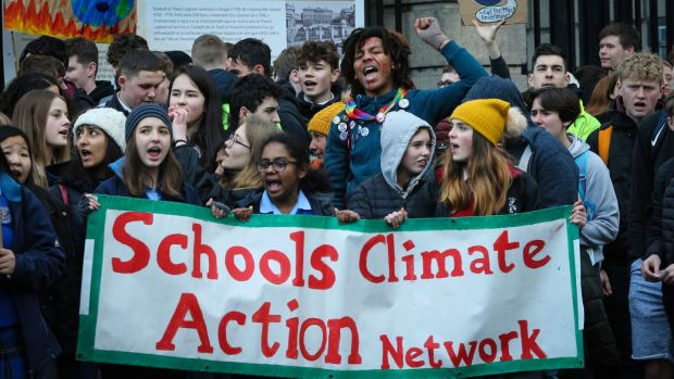 School pupils take part in a students' climate strike outside Leinster House. Photograph Crispin Rodwell
