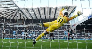 Manchester City goalkeeper Edderson dives in vain as a shot from Jonjo Shelvey sails into the net for the Newcastle equaliser. Photograph:  Stu Forster/Getty Images