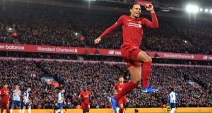 Liverpool's Virgil van Dijk celebrates scoring his second   goal   at Anfield. Photo: Anthony Devlin/PA Wire