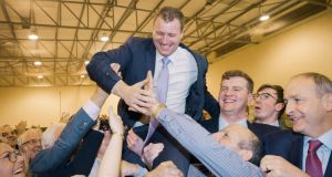 Newly-elected Fianna Fáil TD Padraig O'Sullivan and party leader Micheál Martin celebrate the party's byelection win in Cork North Central on Saturday. Photograph: Provision
