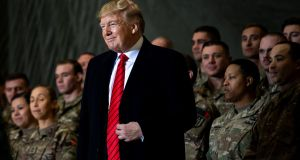 US president Donald Trump with American forces  at Bagram Air Field in Kabul, Afghanistan, on Thanksgiving Day. Photograph: Erin Schaff/New York Times