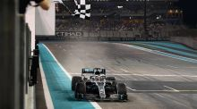 Lewis Hamilton driving the (44) Mercedes AMG Petronas F1 Team Mercedes W10 takes the chequered flag at the end of the Grand Prix of Abu Dhabi at Yas Marina Circuit. Photo: Clive Mason/Getty Images