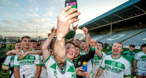 Ballyhale's Conor Walsh and his team-mates share the moment  with team-mate Richie Reid who is currently with the Irish Army  in the Lebanon after the victory over St Mullins in the AIB  Leinster club hurling final. Photograph: James Crombie/Inpho