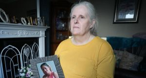 Carol Connors holds a photograph of her daugher Anne Marie who died of a drug overdose in supported accommodation. Photograph: Nick Bradshaw