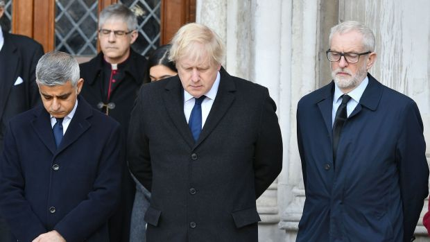 Mayor of London Sadiq Khan, British prime minister Boris Johnson and Labour leader Jeremy Corbyn take part in a vigil in Guildhall Yard, London. Photograph: Dominic Lipinski/PA Wire