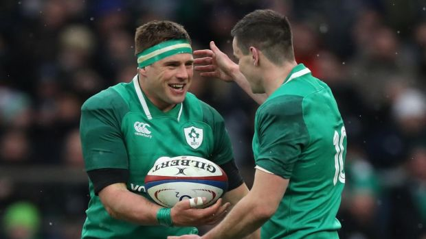 CJ Stander is congratulated by his Ireland team-mate Johnny Sexton after scoring a try during the Six Nations match against England at Twickenham on St Patrick's Day, 2018. Photograph: David Rogers/RFU/Getty Images