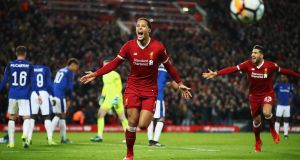 Virgil van Dijk of Liverpool celebrates after scoring their second goal during the  FA Cup third-round match against  Everton at Anfield in  January, 2018. Photograph: Clive Brunskill/Getty Images