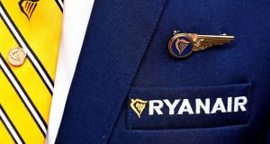 A Ryanair logo is pictured on the the jacket of a cabin crew member. The airline will begin a court battle today with chief operating officer Peter Bellew, who is planning to take up a senior role in January with rival airline Easyjet. Photograph:  REUTERS/Francois Lenoir/File Photo