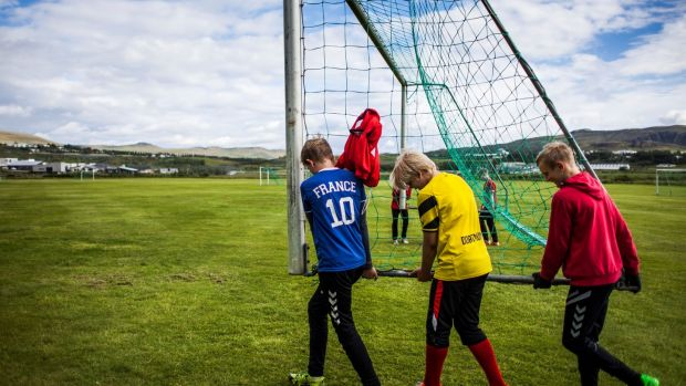 "Teenage boys attend a training session at the football club Afturelding in Mosfellsbaer, near Reykjavik. In Iceland a ""leisure card"", worth €430 a year, is available for children to help fund out-of-school activities. Photograph: Karl Petersson/AFP"