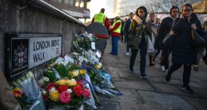 Floral tributes at the scene of the London Bridge attack on Monday. Photograph:  Peter Summers/Getty Images