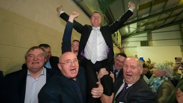 Fianna Fáil's Malcolm Byrne is held aloft by supporters following his victory in the Wexford byelection. Photograph: Patrick Browne