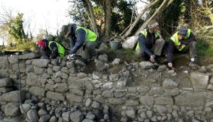 Archaeological assistants uncover the fosse of the medieval Carrickmines Castle at Carrickmines, Co Dublin, in 2002. Photograph: Joe St Leger