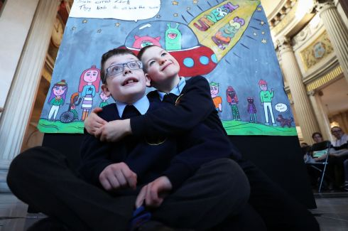 SOMEONE LIKE ME: Ethan O'Brien and Luke McLoughlin, of The Downs National School Mullingar, as pupils and teachers from 49 primary schools gathered for the announcement of the winner of the Someone Like Me art competition, on International Day of People with Disabilities. Photograph: Nick Bradshaw