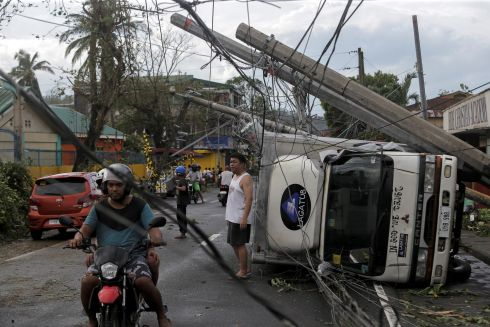 TYPHOON AFTERMATH: Residents take stock after Typhoon Kammuri caused much destruction at Camalig town, the Philippines. Photograph: Nino Luces/Reuters