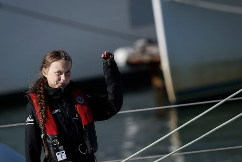 RETURN TRIP: Swedish climate crisis activist Greta Thunberg (16) waves as she arrives at Santo Amaro Dock, at Lisbon, Portugal, after crossing the Atlantic on the catamaran La Vagabonde. She was then due to leave for Madrid for the UN climate summit, entitled COP25. Photograph: Rodrigo Antunes/EPA