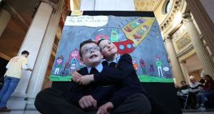 Ethan O'Brien and Luke McLoughlin at the results of an art competition for  the International Day of People with Disabilities. Photograph Nick Bradshaw