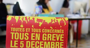 "A poster stating ""All on strike on December 5th"" at the Bourse du Travail during preparations for a national strike against French government pension reform plans, in Nice, France. Photograph: Eric Gaillard/Reuters"