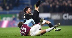 Jeff Hendrick tackles David Silva during Burnley's defeat to Manchester City. Photograph: Stu Forster/Getty