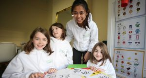LearnChinese.ie is hiring teachers directly from China to teach Mandarin in Irish children . Pictured are (from left) O'Donovan girls Alexandra (9), Claudia (5), Teacher YuSyuan Chen and Allegra (7). Photograph: Nick Bradshaw