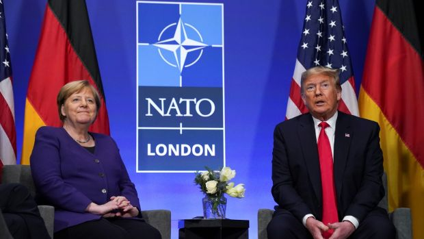 US president Donald Trump and German chancellor Angela Merkel speak to the press at the Nato summit in Watford on Wednesday. Photograph: Kevin Lamarque/Reuters