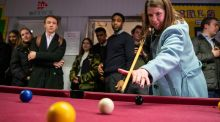 Election cue: Liberal Democrat leader Jo Swinson plays pool at a youth centre while Extinction Rebellion protest outside. Photograph: Aaron Chown / PA Wire