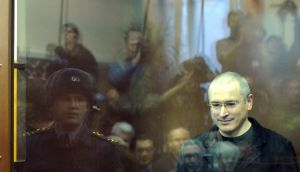 Mikhail Khodorkovsky  behind a glass wall at a courtroom in Moscow in December 2010 on embezzlement  charges relating to his oil company  Yukos. Photograph: Alexander Nemenov/AFP via Getty Images