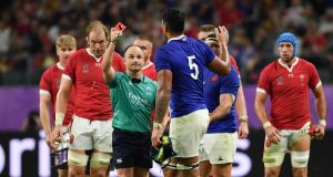 Referee Jaco Peyper shows a red card to Frances's Sebastien Vahaamahina during the  Rugby World Cup quarter-final in Oita. Photograph:  Ashley Western/PA Wire