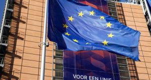 An EU flag flies in front of the European Commission headquarters in Brussels. Photograph: Aris Oikonomou/AFP