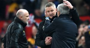 Manchester United manager Ole Gunnar Solskjaer and José Mourinho shake hands after the Premier League clash at Old Trafford. Photo: Stu Forster/Getty Images