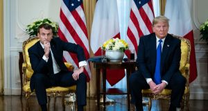 President Donald Trump meets with French president Emmanuel Macron   at Winfield House in London on Tuesday. Photograph: Al Drago/The New York Times