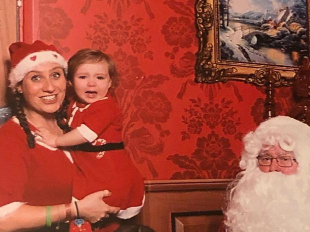 Conor Pope's wife, Sonia, with their daughter Ruby, meeting Santa for the first time at Center Parcs