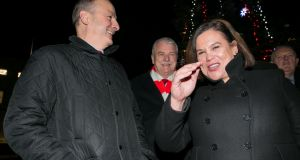 Micheál Martin and Sinn Féin leader Mary Lou McDonald TD at the switching on of the Oireachtas Christmas tree lights at Leinster House. Photograph: Gareth Chaney/Collins