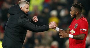 Ole Gunnar Solskjaer celebrates with Fred after Manchester United's win over Tottenham. Photograph: Lynne Cameron/EPA