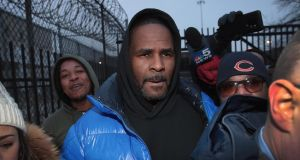R Kelly leaving jail on bail in Chicago in February. He had been held after turning himself in to face 10 counts of aggravated sexual abuse.  Photograph: Scott Olson/Getty
