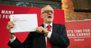 Labour Party leader Jeremy Corbyn holds up a leaked document relating to Northern Ireland, during a press conference in central London. Photograph:   Jonathan Brady/PA