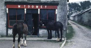 Before the multinationals: from 1921 to 1991 the Irish economy was the worst performer in western Europe; this photograph, by Hans Silvester of Gamma-Rapho, shows Toomey's bar in Hollywood, Co Wicklow, in the 1950s