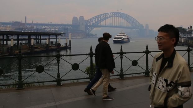 A view of the Sydney Harbour Bridge engulfed by smoke haze from bushfires in Sydney, on December 2nd. Photograph: Steven Saphore/EPA