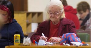 Eileen Flaherty (91), from Riverstown, Co Sligo, marks her bingo card at St Ronan's Hall, Keadue, Co Roscommon. Photograph: Brian Farrell/Irish Times