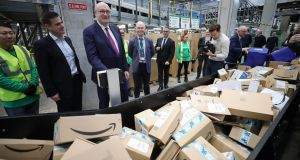 European trade commissioner Phil Hogan and An Post staff at the opening of the company's largely automated parcel hub in Clondalkin, Dublin. Photograph: Nick Bradshaw/The Irish Times.