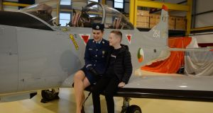 Newly commissioned Air Corps pilot Lauren Cusack with her godson Darragh Brogan at Baldonnell Airbase in Dublin on Friday. Photograph: Alan Betson/The Irish Times.