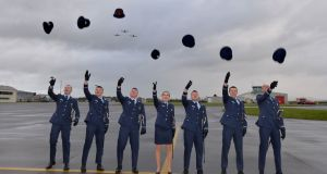 HATS OFF: Members of the 35th Air Corps cadet class celebrate at their commissioning ceremony in Baldonnel, Dublin. Photograph: Alan Betson/The Irish Times