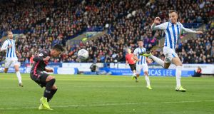 Pablo Hernandez doubles Leeds' lead against Huddersfield. Photograph: George Wood/Getty